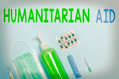 Writing note showing Humanitarian Aid. Business concept for immediate assistance provided after natural and manmade disaster Primary medical precautionary equipments for health care protection