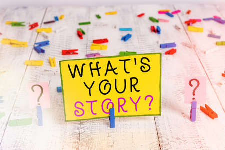 Text sign showing What S Your Story Question. Business photo text Share or tell us your life experiences and success Scribbled and crumbling sheet with paper clips placed on the wooden table