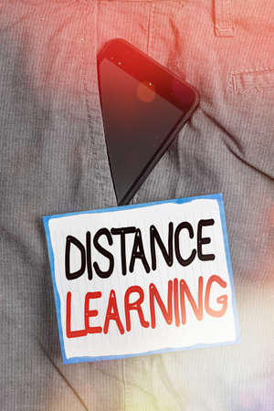 Conceptual hand writing showing Distance Learning. Concept meaning educational lectures broadcasted over the Internet remotely Smartphone device inside trousers front pocket note paper