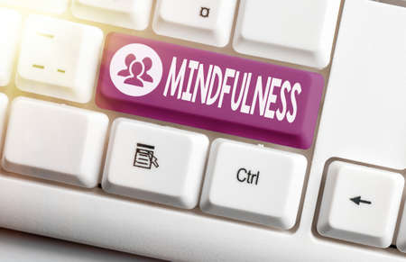 Handwriting text Mindfulness. Conceptual photo state of mind attained by concentrating one s is attention Different colored keyboard key with accessories arranged on empty copy space