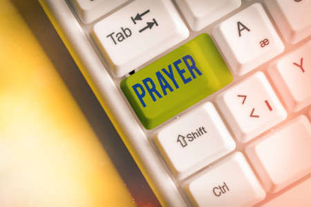 Writing note showing Prayer. Business concept for solemn request for help or expression of thanks addressed to God White pc keyboard with empty note paper above white key copy space