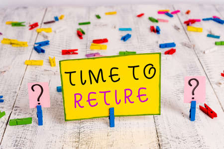Text sign showing Time To Retire. Business photo text bank savings account, insurance, and pension planning Scribbled and crumbling sheet with paper clips placed on the wooden table