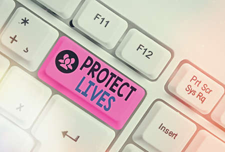 Word writing text Protect Lives. Business photo showcasing to cover or shield from exposure injury damage or destruction White pc keyboard with empty note paper above white key copy space Archivio Fotografico