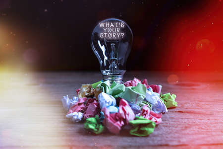Handwriting text What S Your Story Question. Conceptual photo Share or tell us your life experiences and success Realistic colored vintage light bulbs, idea sign solution thinking concept