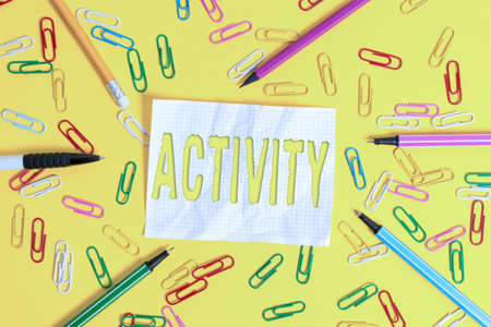 Writing note showing Activity. Business concept for the condition where many things are happening or move around Flat lay above empty paper with pencils and paper clips