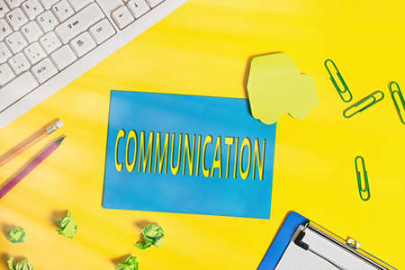 Text sign showing Communication. Business photo text a system whereby information is exchanged between individuals Flat lay above empty paper with copy space and colored paper clips