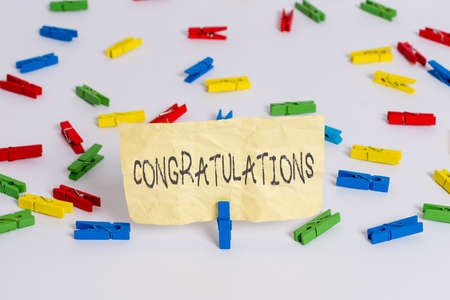 Handwriting text writing Congratulations. Conceptual photo a special occasion that expressing gratitude or good wishes Colored clothespin papers empty reminder white floor background office