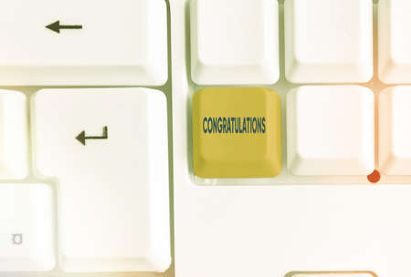 Writing note showing Congratulations. Business concept for a special occasion that expressing gratitude or good wishes Colored keyboard key with accessories arranged on empty copy space