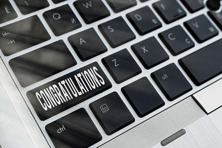 Word writing text Congratulations. Business photo showcasing a special occasion that expressing gratitude or good wishes Pc keyboard key with empty note paper above background copy space
