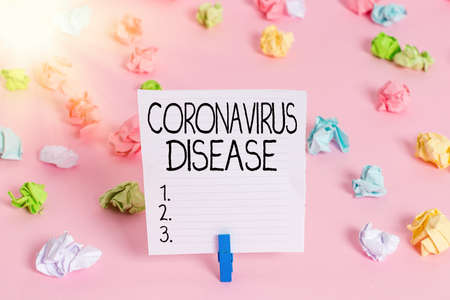 Conceptual hand writing showing Coronavirus Disease. Concept meaning defined as illness caused by a novel virus SARSCoV2 Colored crumpled papers empty reminder pink floor clothespin Banco de Imagens