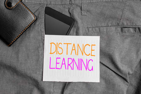 Conceptual hand writing showing Distance Learning. Concept meaning educational lectures broadcasted over the Internet remotely Smartphone device inside trousers front pocket with wallet Banco de Imagens