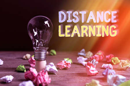 Writing note showing Distance Learning. Business concept for educational lectures broadcasted over the Internet remotely Realistic colored vintage light bulbs, idea sign solution