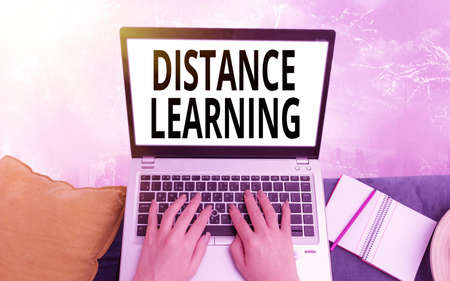 Conceptual hand writing showing Distance Learning. Concept meaning educational lectures broadcasted over the Internet remotely Modern gadgets white screen under colorful bokeh background