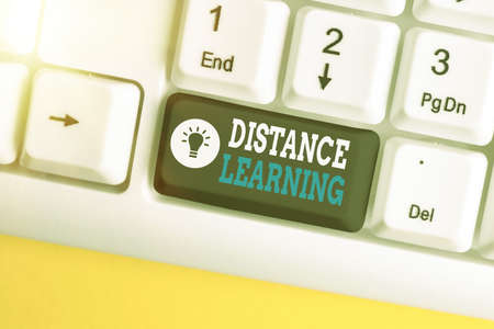 Text sign showing Distance Learning. Business photo text educational lectures broadcasted over the Internet remotely Different colored keyboard key with accessories arranged on empty copy space