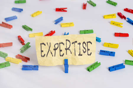 Handwriting text writing Expertise. Conceptual photo specific competences of skills gained through training practice Colored clothespin papers empty reminder white floor background office
