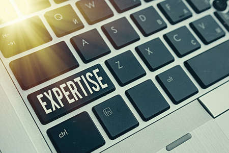 Word writing text Expertise. Business photo showcasing specific competences of skills gained through training practice Pc keyboard key with empty note paper above background copy space