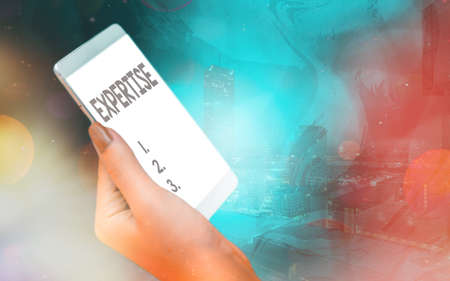 Handwriting text Expertise. Conceptual photo specific competences of skills gained through training practice Modern gadgets with white display screen under colorful bokeh background