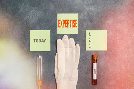 Word writing text Expertise. Business photo showcasing specific competences of skills gained through training practice Extracted blood sample vial with medical accessories ready for examination
