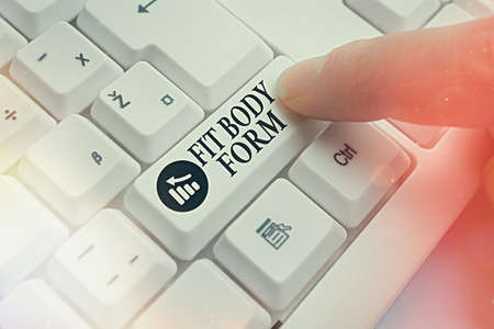 Conceptual hand writing showing Fit Body Form. Concept meaning refers to a body that perfectly aligns of shape and contour Pc keyboard key with pointing finger above background copy space