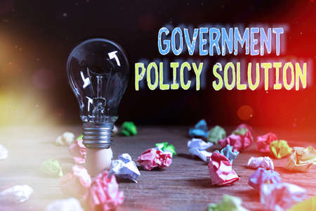 Writing note showing Government Policy Solution. Business concept for designed game plan created in response to emergency disaster Realistic colored vintage light bulbs, idea sign solution Stok Fotoğraf