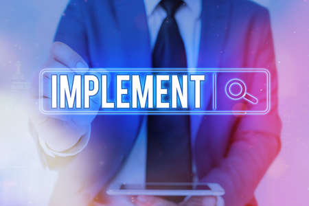 Writing note showing Implement. Business concept for give practical effect to specific steps to ensure real attainment Web search digital information futuristic technology network connection Stock Photo