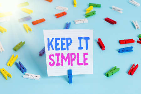 Word writing text Keep It Simple. Business photo showcasing ask something easy understand not go into too much detail Colored clothespin papers empty reminder blue floor background office pin 版權商用圖片