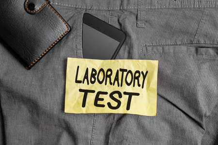 Writing note showing Laboratory Test. Business concept for Determination of a medical diagnosis from the substances tested Smartphone device inside trousers front pocket with wallet