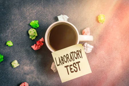 Writing note showing Laboratory Test. Business concept for Determination of a medical diagnosis from the substances tested Paper accessories with smartphone arranged on different background Banque d'images
