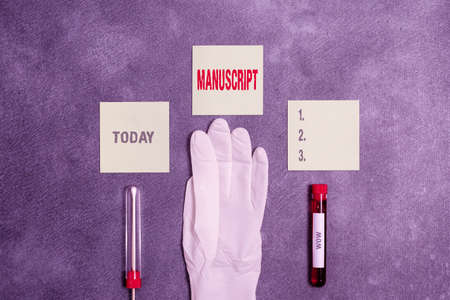 Word writing text Manuscript. Business photo showcasing handwritten text or piece of music rather than typed or printed Extracted blood sample vial with medical accessories ready for examination 스톡 콘텐츠