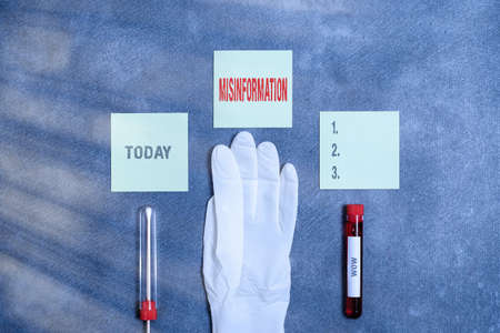 Word writing text Misinformation. Business photo showcasing false data, in particular, intended intentionally to deceive Extracted blood sample vial with medical accessories ready for examination