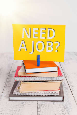 Conceptual hand writing showing Need A Job Question. Concept meaning to recruit an individual for specific duty role or function pile stacked books notebook pin color reminder white wooden