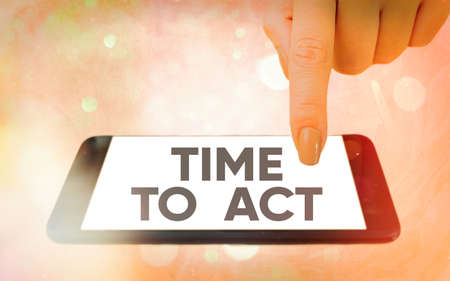 Text sign showing Time To Act. Business photo showcasing the right moment to start working or doing stuff right away Modern gadgets with white display screen under colorful bokeh background