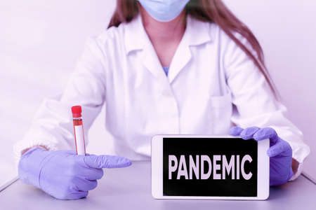 Writing note showing Pandemic. Business concept for occurring over a wide area affecting high proportion of population Laboratory blood test sample for medical diagnostic analysis Stock fotó
