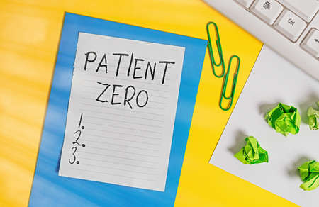 Word writing text Patient Zero. Business photo showcasing primary disease carrier of the highlycontagious disease Flat lay above empty copy space white paper with paper clips on the table