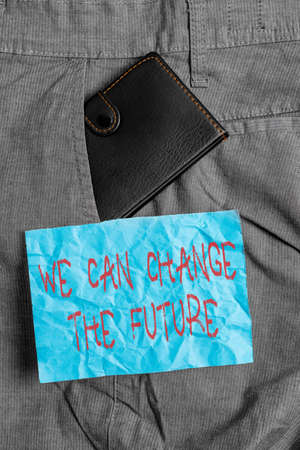 Text sign showing We Can Change The Future. Business photo showcasing Make actions to achieve different results Small little wallet inside man trousers front pocket near notation paper Banco de Imagens