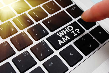 Text sign showing Who Am I Question. Business photo text asking about selfidentity or an individualal purpose in life Pc keyboard key with pointing finger above background copy space
