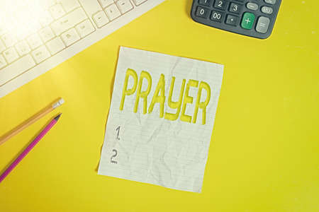 Writing note showing Prayer. Business concept for solemn request for help or expression of thanks addressed to God Copy space on notebook above yellow background with keyboard on table