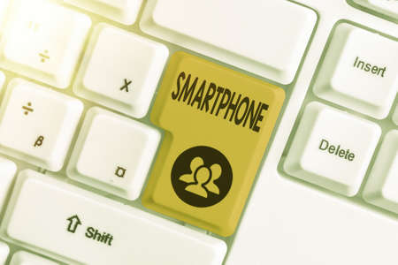 Handwriting text writing Smartphone. Conceptual photo a mobile phone that performs many of the computer s is features Different colored keyboard key with accessories arranged on empty copy space