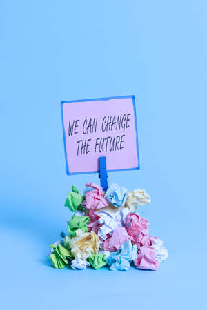 Writing note showing We Can Change The Future. Business concept for Make actions to achieve different results Reminder pile colored crumpled paper clothespin wooden space Banco de Imagens