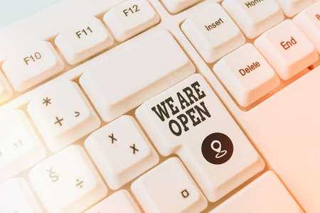 Text sign showing We Are Open. Business photo showcasing no enclosing or confining barrier, accessible on all sides Pc keyboard key with empty note paper above background copy space