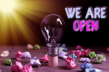 Word writing text We Are Open. Business photo showcasing no enclosing or confining barrier, accessible on all sides Realistic colored vintage light bulbs, idea sign solution thinking concept