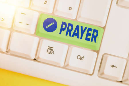 Text sign showing Prayer. Business photo showcasing solemn request for help or expression of thanks addressed to God Different colored keyboard key with accessories arranged on empty copy space