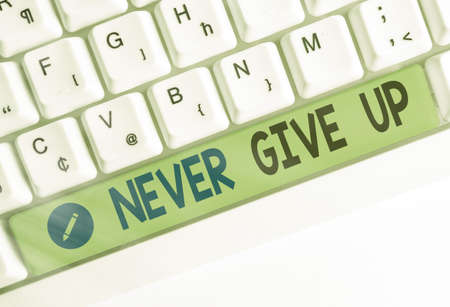 Word writing text Never Give Up. Business photo showcasing be persistent to keep on trying to improve the condition Different colored keyboard key with accessories arranged on empty copy space