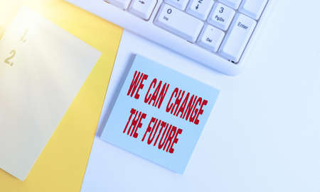 Handwriting text We Can Change The Future. Conceptual photo Make actions to achieve different results Empty blank paper with copy space and pc keyboard above orange background table Banco de Imagens