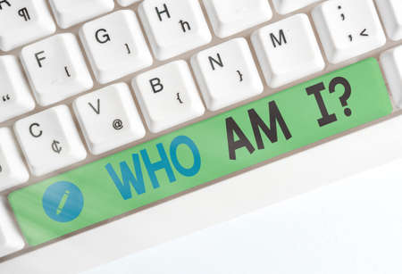 Word writing text Who Am I Question. Business photo showcasing asking about selfidentity or an individualal purpose in life Different colored keyboard key with accessories arranged on empty copy space Stock fotó