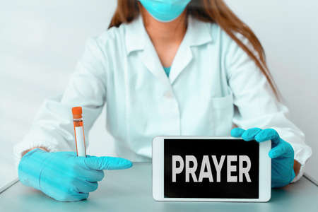 Writing note showing Prayer. Business concept for solemn request for help or expression of thanks addressed to God Laboratory blood test sample for medical diagnostic analysis