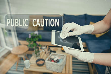 Handwriting text writing Public Caution. Conceptual photo formal warning given to the public to express a potential risk Contamination within electronic gadgets sufaces controlled by disinfectant Stock Photo