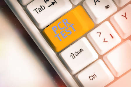 Text sign showing Pcr Test. Business photo showcasing qualitative detection of viral genome within the short seqeunce of DNA Different colored keyboard key with accessories arranged on empty copy space