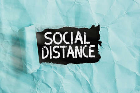 Handwriting text Social Distance. Conceptual photo maintaining a high interval physical distance for public health safety Rolled ripped torn cardboard placed above a wooden classic table backdrop Standard-Bild