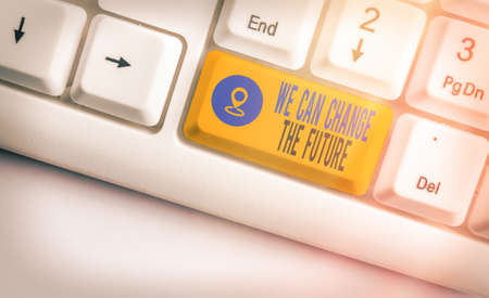 Writing note showing We Can Change The Future. Business concept for Make actions to achieve different results Colored keyboard key with accessories arranged on empty copy space